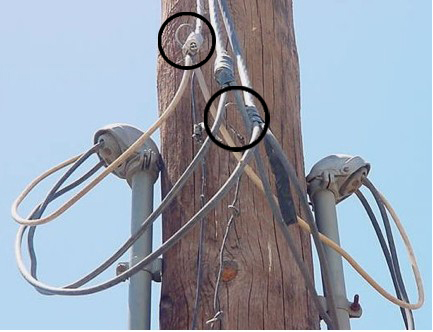 Fish hooks used to penetrate power lines and steal electricity