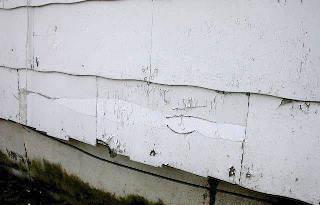 Asbestos cement siding