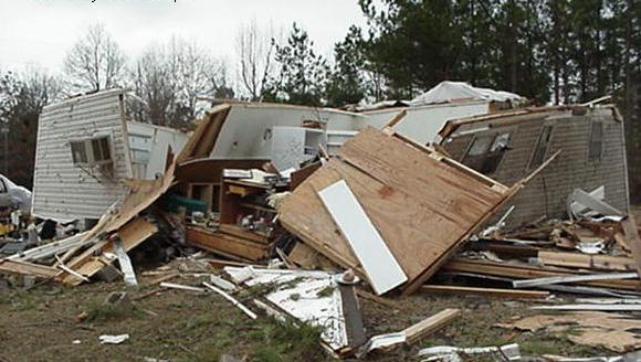 A conventional home may withstand the effects of an EF2 tornado, but it destroyed this mobile home.