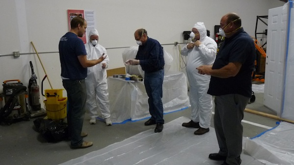 InterNACHI's Director of Education Ben Gromicko (far left) instructs Lead-Safety RRP course participants in the proper personal protective equipment during hands-on training in April 2011