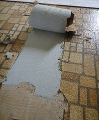 ... This Older Style Of Vinyl Flooring Has Been Peeled Back To Reveal A  Layer Of Asbestos
