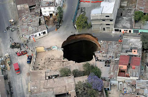An enormous sinkhole opens up in Guatemala, swallowing buildings and killing several people