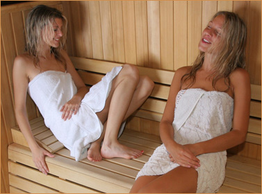 Women enjoying a sauna; not InterNACHI models, who are just as -- if not more -- attractive