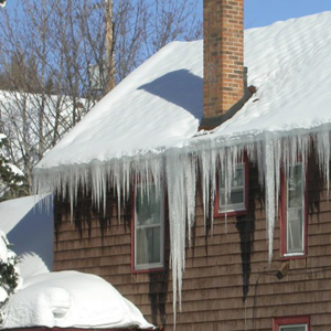 Notice how the ice is<br /> heaviest beneath the chimney, where snow can be melted easily