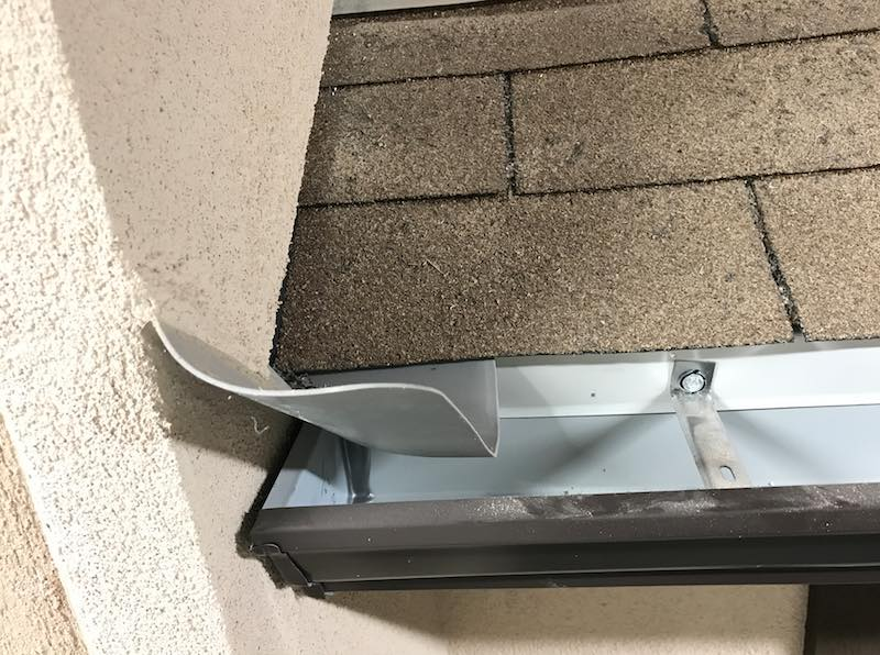 Inspecting Step And Kick Out Flashing At Roof Wall