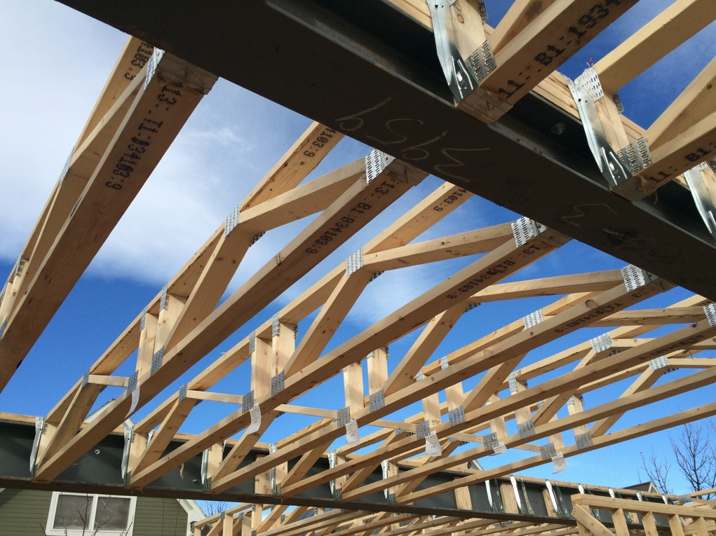 Reinforce roof beams inside view of trusses for Structural design of a house