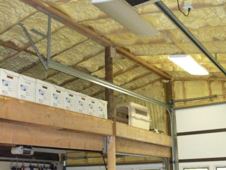 Inspecting Spray Foam Insulation Applied Under Plywood And