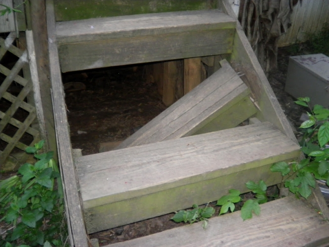 An inspector may choose to notify all parties of a hazard even as obvious as this broken porch step, just in case someone at the property isn't paying attention.