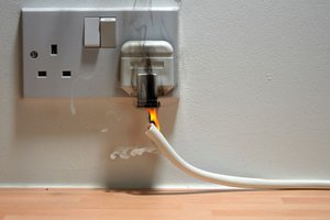This faulty electrical outlet could start a house fire and may be categorized as an imminent hazard.
