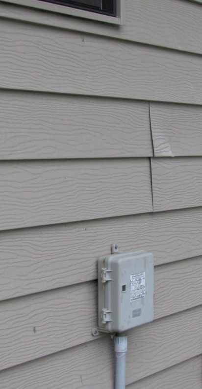 This steel siding is showing evidence of uplift.  (Photo from the Baranek Blog)