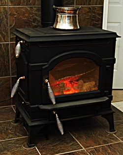 Wood burning stoves int 39 l association of certified home for Most efficient small wood burning stove